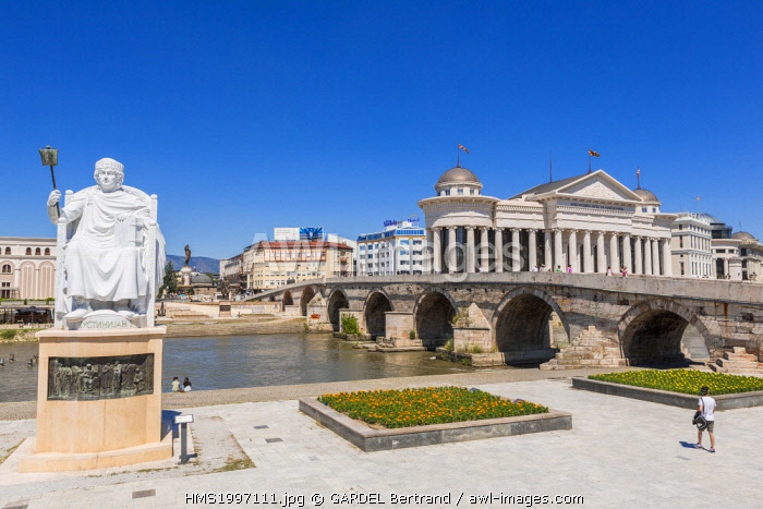 awl-images.com - Macedonia / Republic of Macedonia, Skopje, the Stone Bridge over the Vardar river, the Archeological Museum of Macedonia in the background and the statue of the Emperor Justinian I
