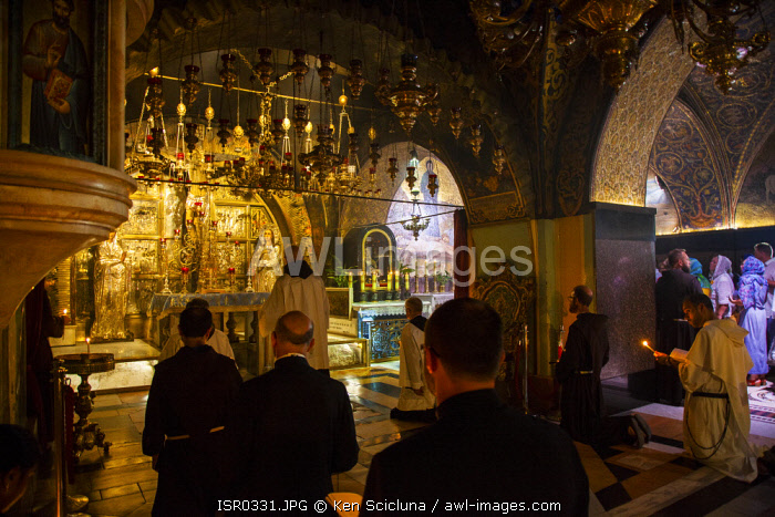 awl-images.com - Israel / Israel, Jerusalem. Roman Catholic monks and priests praying as part of the Sunday celebrations at the chapel which is believed to have been Jesus Christ s place of crucifixion or the Golgotha.