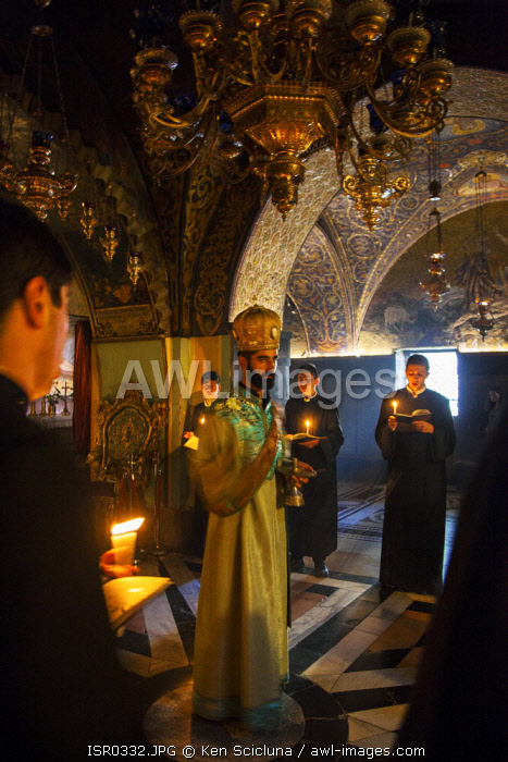 awl-images.com - Israel / Israel, Jerusalem. The Armenian Orthodox ceremony as part of the Sunday celebrations at the chapel which is believed to have been Jesus Christ s place of crucifixion or the Golgotha.