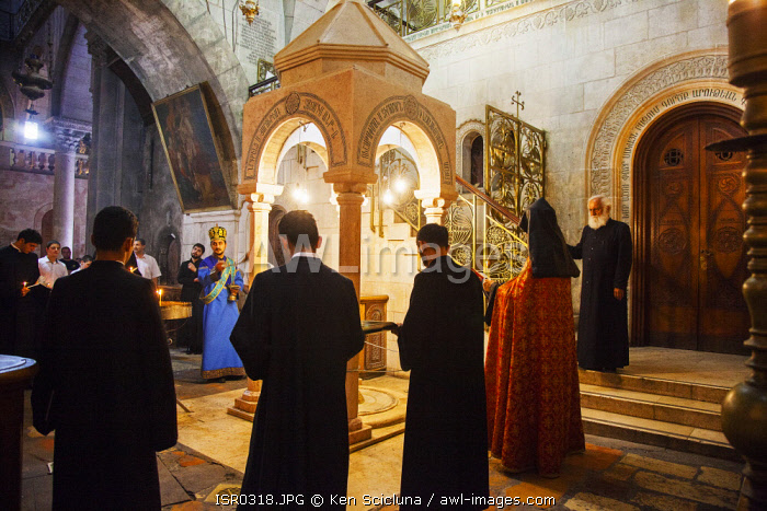 awl-images.com - Israel / Israel, Jerusalem. The Armenian Orthodox ceremony in front of the marble canopy marking the Station fo the Holy Women as part of the Sunday celebrations at the Stone of the Anointing or Stone of Unction at the entrance of the Church of the Holy Sepulchre.
