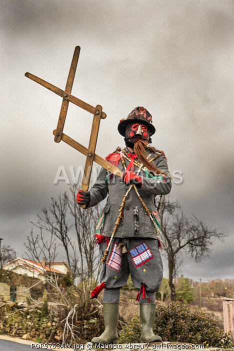 "awl-images.com - Portugal / The ""carocho"", the character thats ""steals"" the sausages of the villagers with the huge tweezers. Traditional Winter festivities in Constantim. Miranda do Douro, Tras-os-Montes. Portugal"