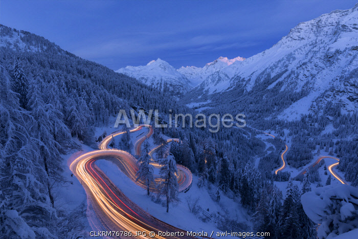awl-images.com - Switzerland / Car lights on the hairpin bends at night, Maloja Pass, Engadin, canton of Graubunden, Switzerland