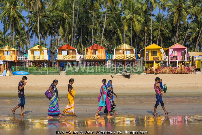 India, Goa, People walking along Palolem Beach