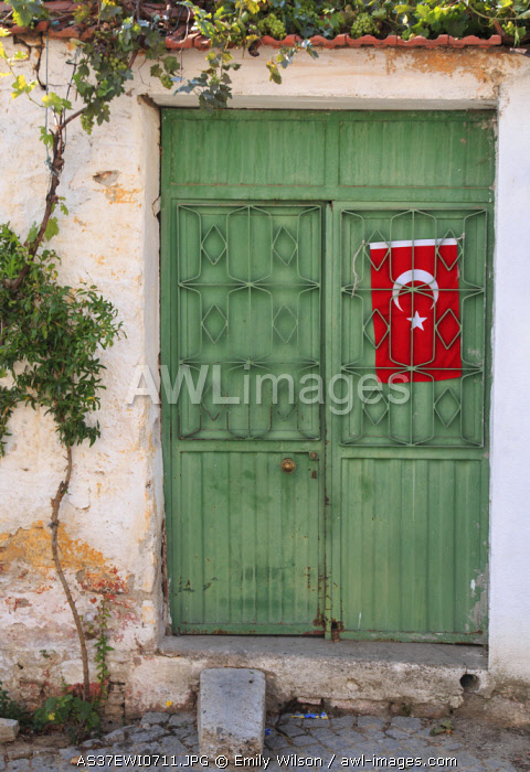 Turkey, Izmir Province, Selcuk, neighborhood and street scenes. Green door, Turkish flag. (Editorial Use Only)