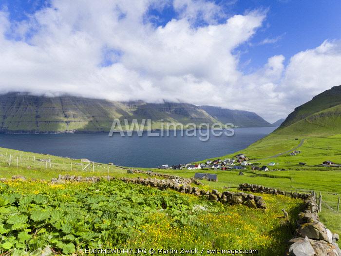 Village Mikladalur, on the Island Kalsoy, in background the island Kunoy. Faroe Islands, Denmark