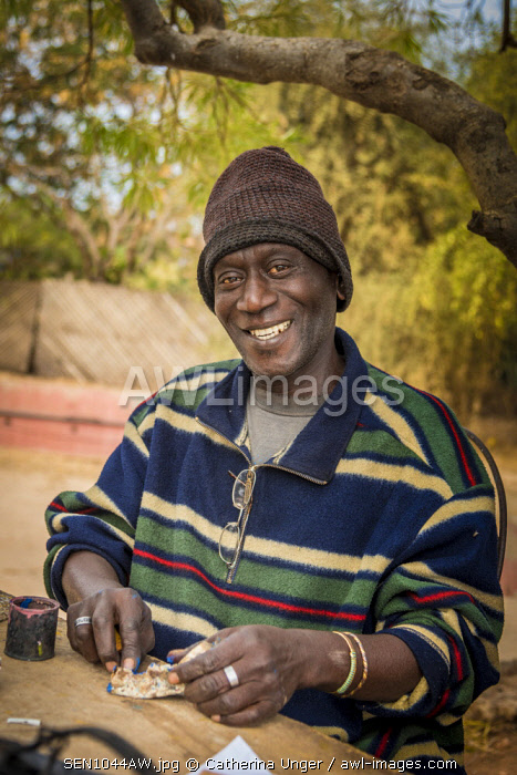 Africa, Senegal, Dakar. An artist on the island Goree.