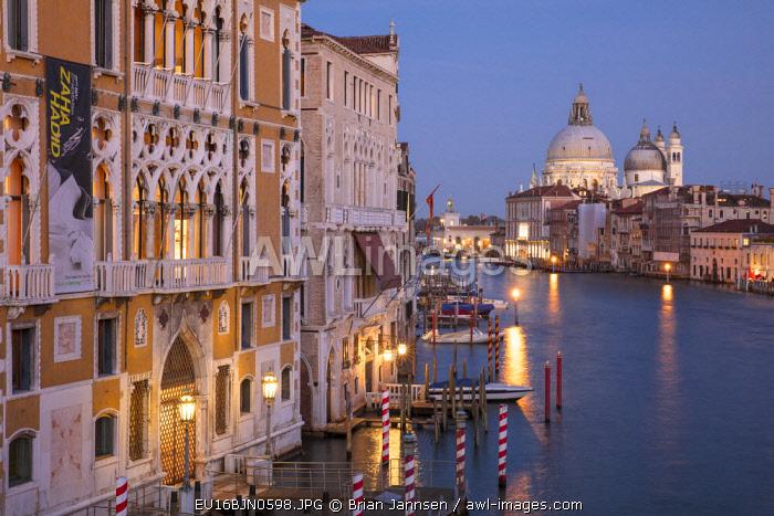 Twilight over the buildings along the Grand Canal with Santa Maria della Salute, Venice, Veneto, Italy