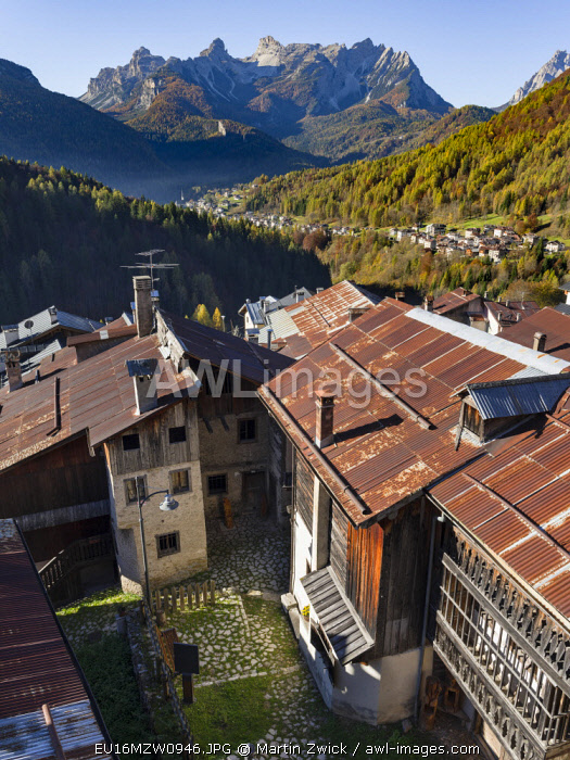 View towards the Tamer mountain range in the dolomites. Village Fornsesighe, an example of the local and original alpine architecture of the Veneto in the dolomites, UNESCO World Heritage Site, Italy