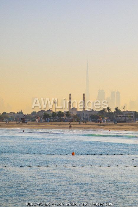 Burj Khalifa and mosque minarets, Dubai, United Arab Emirates