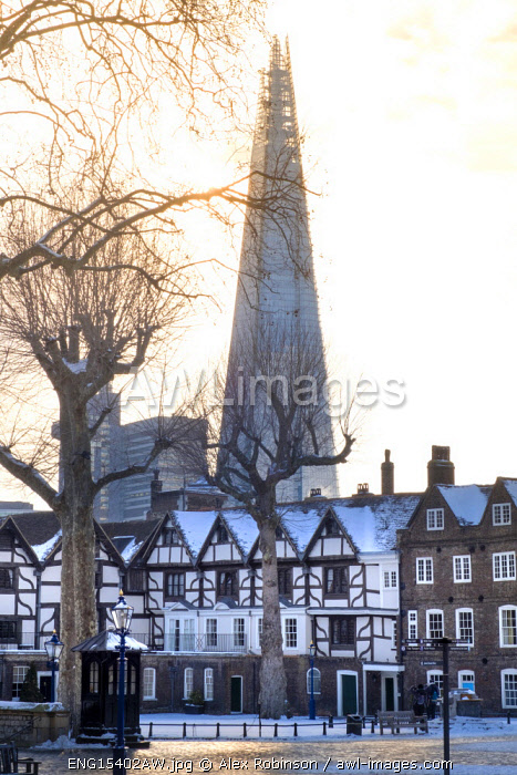 United Kingdom, England, London, Tower of London Unesco World Heritage Site, Tudor houses on Tower Green in the snow with the Shard in the background