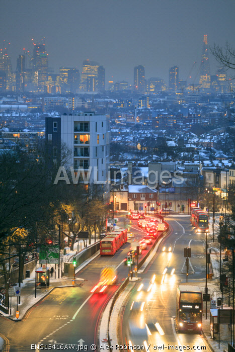 United Kingdom, England, London, Archway, elevated view of the skyline of London showing the A1 Archway road and houses covered in snow