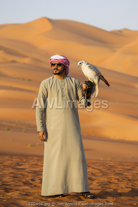 Man with falcon, Empty Quarter (Rub Al Khali), Abu Dhabi, United Arab Emirates (MR)
