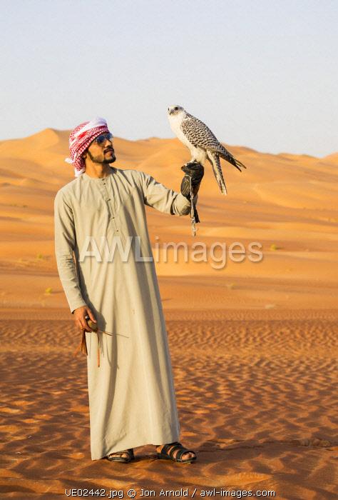 Man with falcon, Empty Quarter (Rub Al Khali), Abu Dhabi, United Arab Emirates (MR)