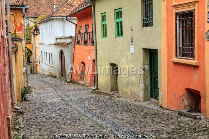 Romania. Mures County, Sighisoara. Cobblestone streets.