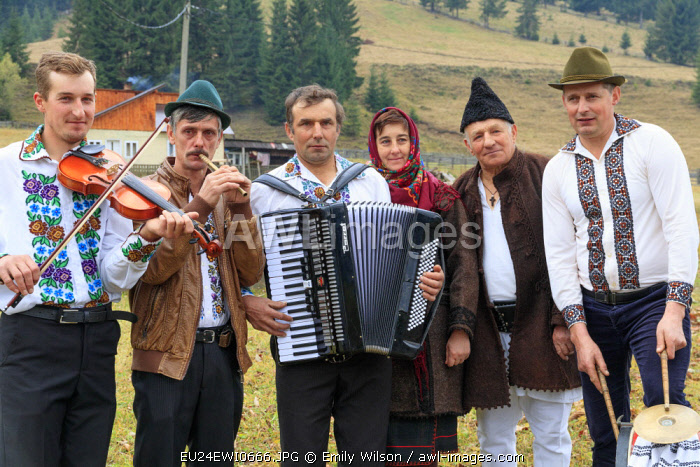 Romania. Moldovita. Village musicians, dancers and patrons of the local cafe. Ensemble of dancers and musicians.