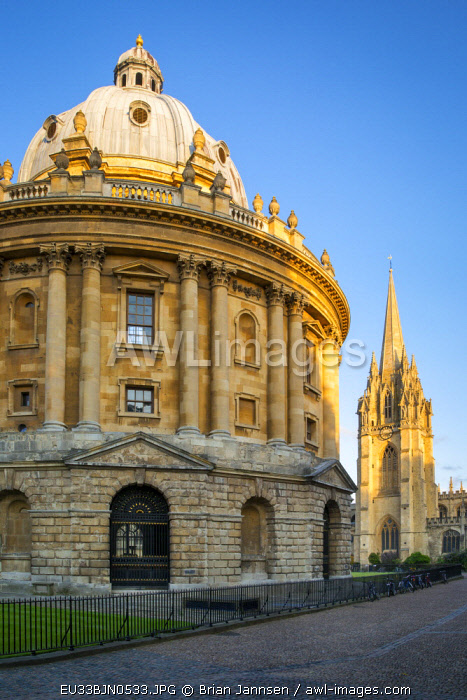Evening view over Radcliffe Camera and spire of St. Mary's, Oxford, Oxfordshire, England