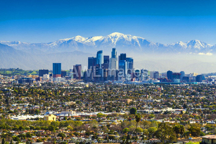 Los Angeles Skyline and Snow Capped San Gabriel Mountains, California, USA