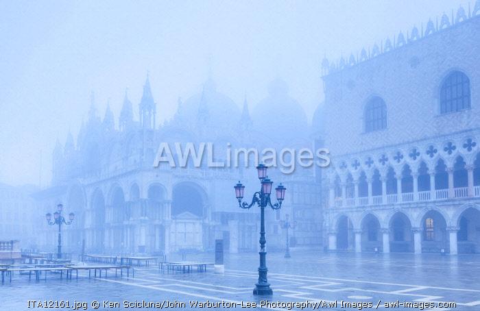 Venice. Veneto. Italy. The San Marco Basilica and Palazzo dei Dogi in Fog.