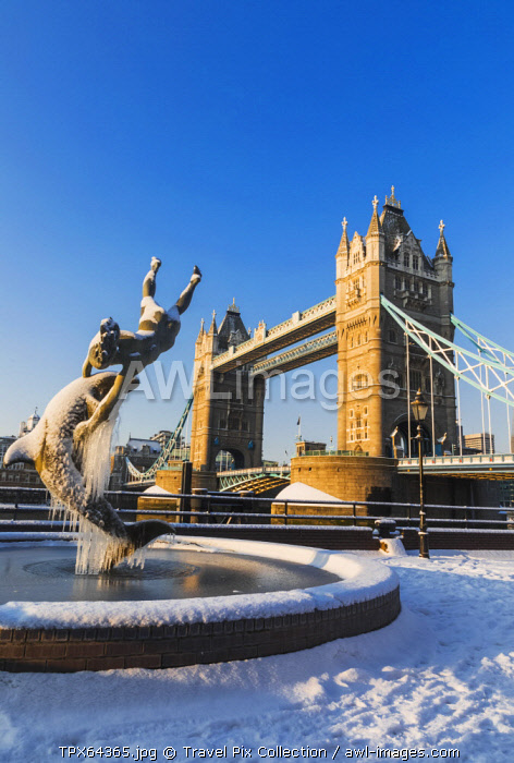 """England, London, Tower Hill, """"The Girl with a Dolphin"""" and Tower Bridge in the Snow"""