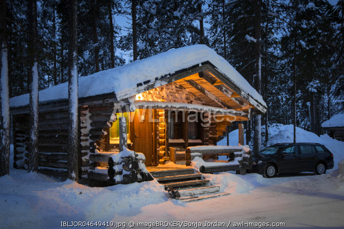 Snow-covered wooden hut, log cabin, Lapland, Finland, Europe
