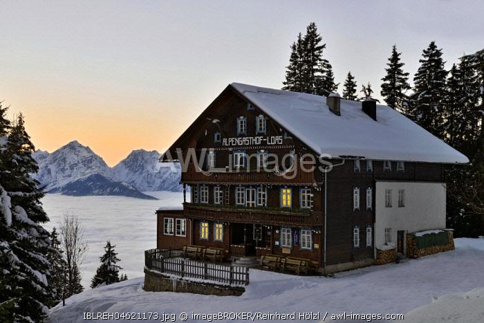 Alpine guest house Loas in a winter landscape at dusk, Schwaz, Tyrol, Austria, Europe