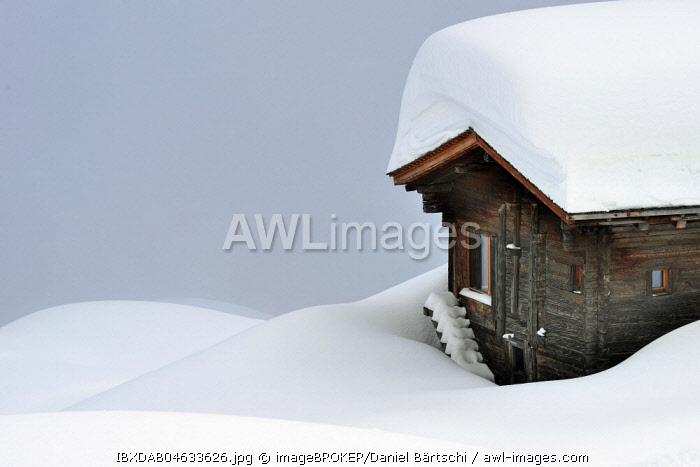 Snow-covered log cabin in the fog, Bettmeralp, Canton Valais, Switzerland, Europe