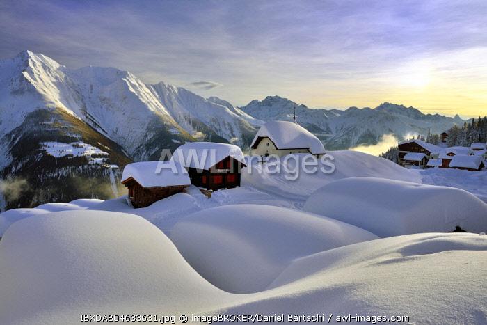Deep snow-covered mountain village, Bettmeralp with chapel Maria zum Schnee in the evening light, Canton Valais, Switzerland, Europe