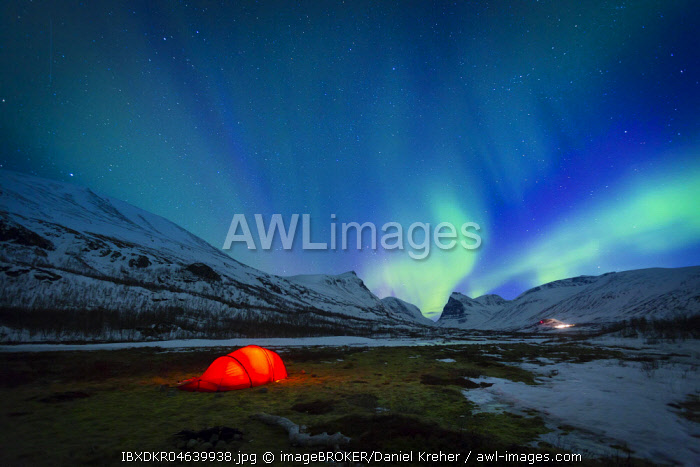 Northern Lights (Aurora borealis) over a tent in winter, Kungsleden or Konigsweg, Province of Lapland, Sweden, Europe