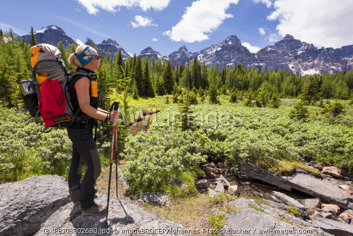 Hiker, Young woman gazes into valley, Valley of the ten Peaks, Banff National Park, Canada, North America