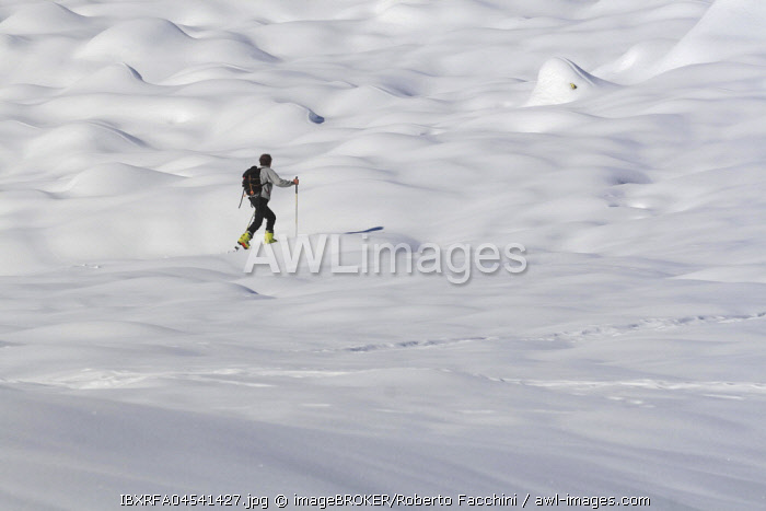 Ski mountaineer, snowy mountain environment, Aosta Valley, Italy, Europe
