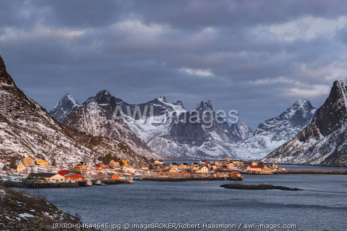 View of the fishing village Reine surrounded by rugged mountains, Reine, Lofoten, Norway, Europe