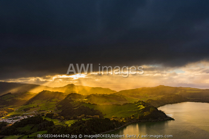 Furnassee with hilly landscape and dramatic atmospheric lighting, dark clouds, Furnas, Sao Miguel, Azores, Portugal, Europe
