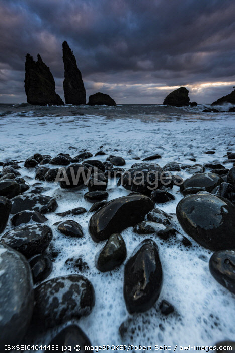 Lava coast, Baía do Cedros with rock needles in the sea, dramatic clouds, Cedros, Flores Island, Azores, Portugal, Europe