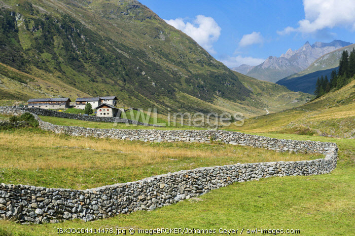Natural stone wall on pasture in mountain valley, Defereggen Valley, High Tauern National Park, Central Eastern Alps, East Tyrol, Austria, Europe