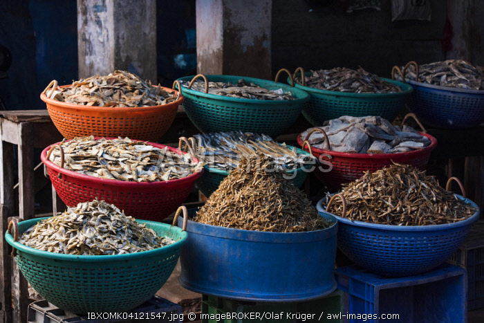 Different types of dried fish in plastic baskets on the market, Broadway Market, Ernakulum, Kerala, India, Asia