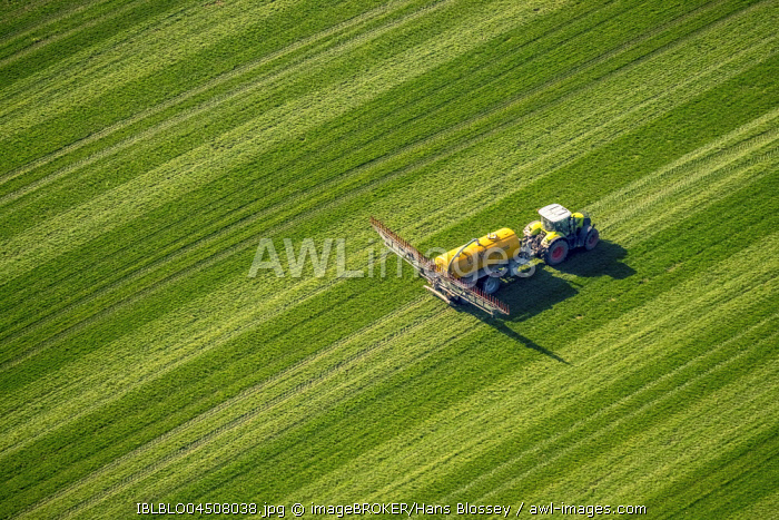 Tractor with pesticide sprayer on meadow, fertilizing, Dorsten, Ruhr district, North Rhine-Westphalia, Germany, Europe