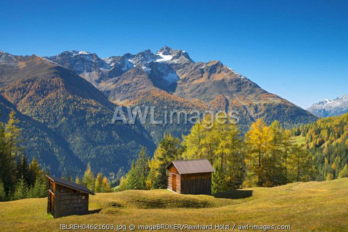 Autumnal mountain landscape with alpine huts, behind Hoher Riffler, Dawin-Alpe, forest meadows, Strengen am Arlberg, Tyrol, Austria, Europe