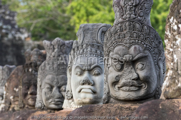 Row of demon statues along the balustrade outside the South Gate of Angkor Thom, Cambodia, Asia