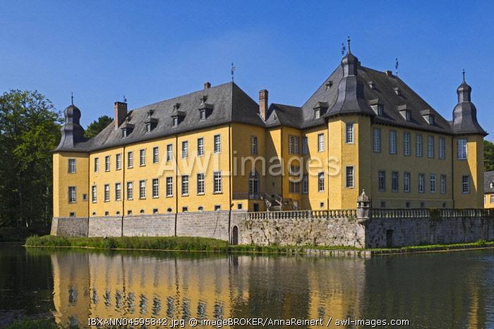Schloss Dyck Castle with water reflection in moat, Juchen, Niederrhein, North Rhine-Westphalia, Germany, Europe
