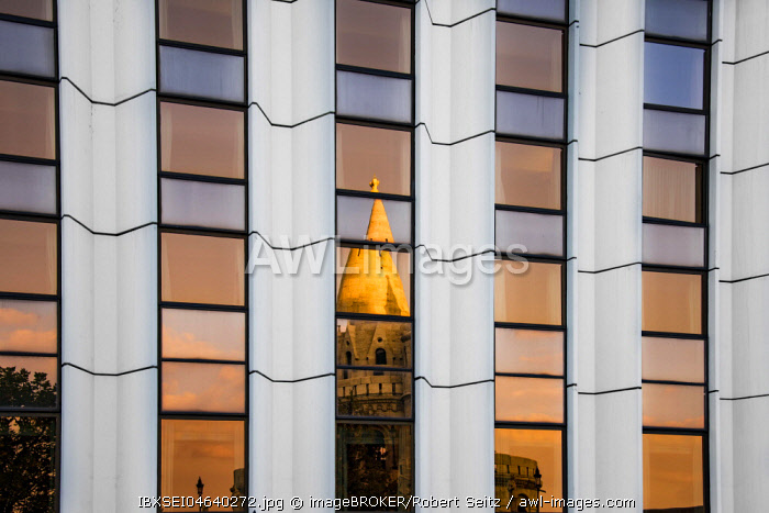 Modern facade of the Hilton Hotel with reflection of the Mathias Church, Budapest, Hungary, Europe