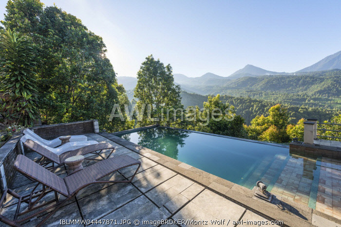 AWL Images Landscape, swimming pool with deck chairs, hills