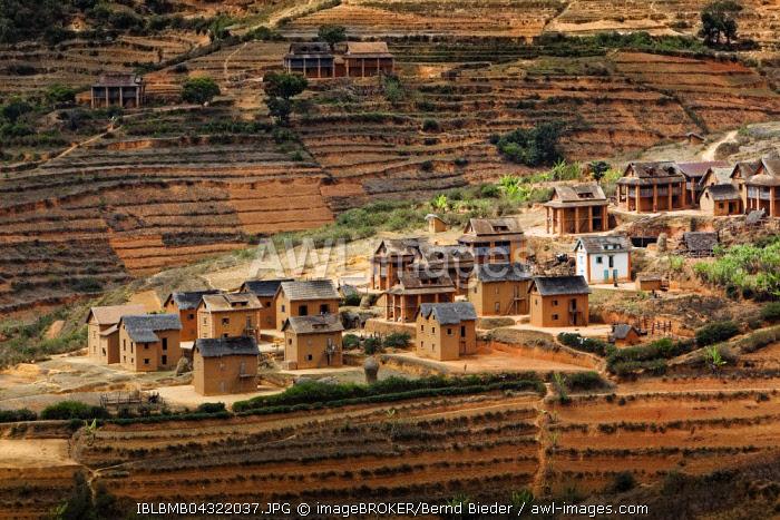 Small mud huts village in the highlands near Fianarantsoa, Madagascar