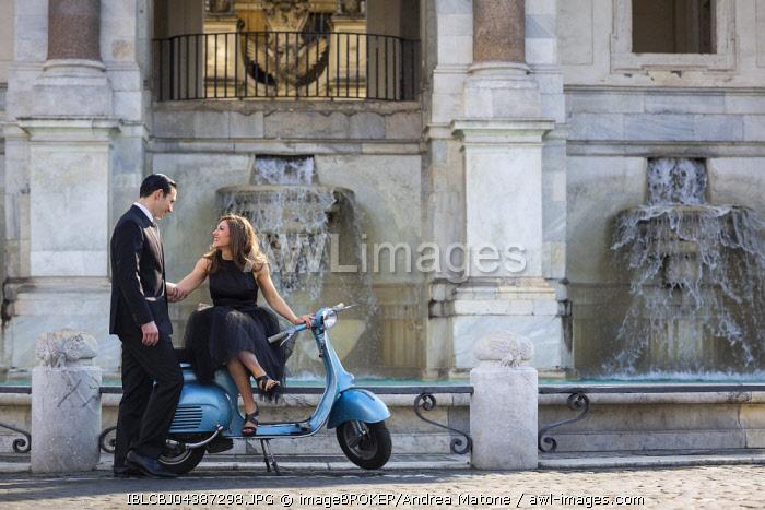 Couple sitting on a Vespa scooter at Fontana dell'Acqua Paola, Il Fontanone, Gianicolo Hill, Janiculum Hill, Rome, Italy, Europe