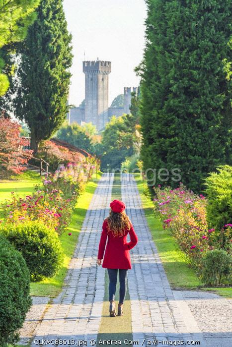 A tourist walks along a pathway in Sigurtv� park. Valeggio sul Mincio, Verona, Veneto, Italy (MR)