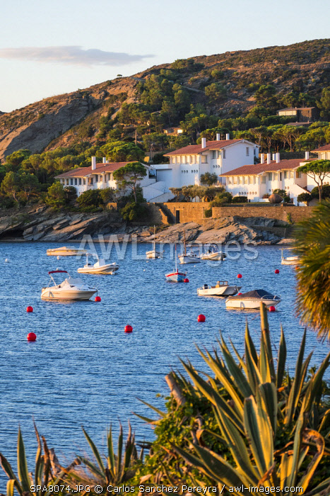 awl-images.com - Spain / Small boats in front of Cadaques, one of the most beautiful villages of the Costa Brava, Catalonia Spain