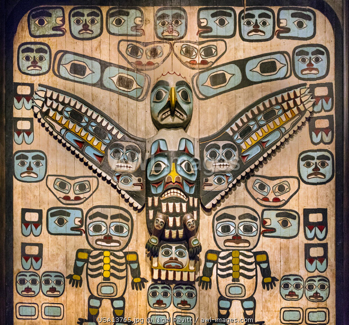 USA, Juneau, Alaska. A carving and painting by the native American Tlingit people displayed in Juneau, the State capital of Alaska.