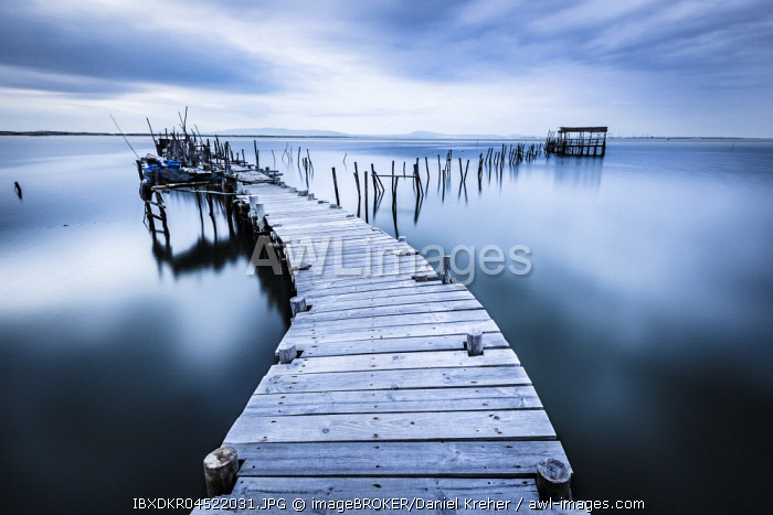 awl-images.com - Portugal / Landing stage in the calm sea, evening mood, Carrasqueira, Alcacer do sal, Portugal, Europe