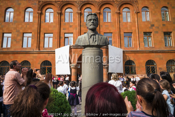 Armenia, Yerevan, Last Bell or last day of school ceremonies at public school, with bust of Russian writer Anton Chekov