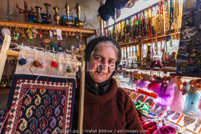 Azerbaijan, Lahic, female shopkeeper in shop, MR