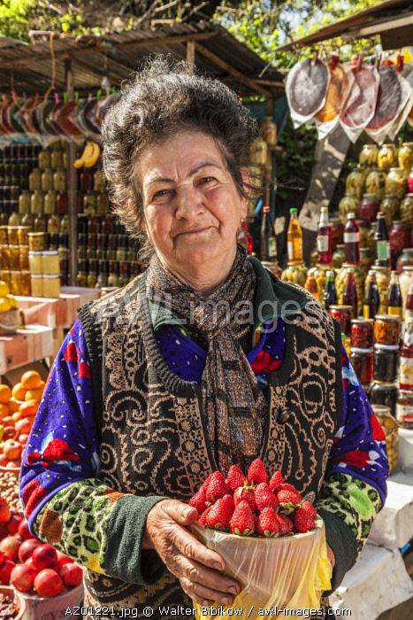 Azerbaijan, Vandam, woman vendor with fruit, MR